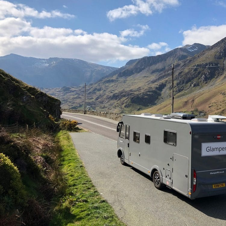 luxury motorhome travelling through mountains