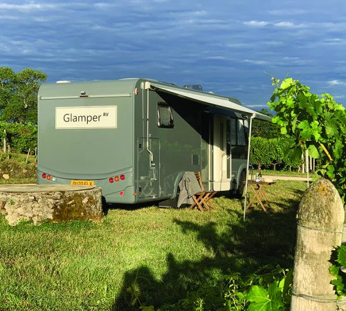 GlamperRV luxury motorhome hire - parked in a vinyard